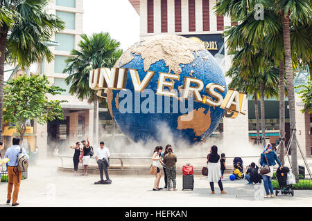 Tourists and theme park visitors taking pictures of the large rotating globe fountain in front  Universal Studios - Stock Photo