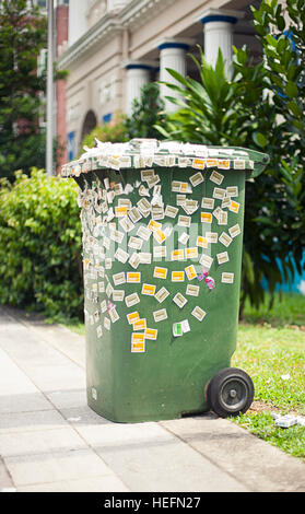 Large green trash box with stickers - Stock Photo