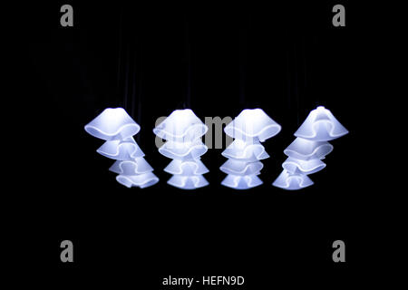 Bright Lamps shine in a black room - Stock Photo