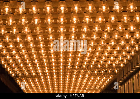 Ceiling covered in filament light bulbs for background use - Stock Photo