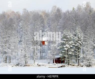 Croft in winter landscape, Sweden - Stock Photo