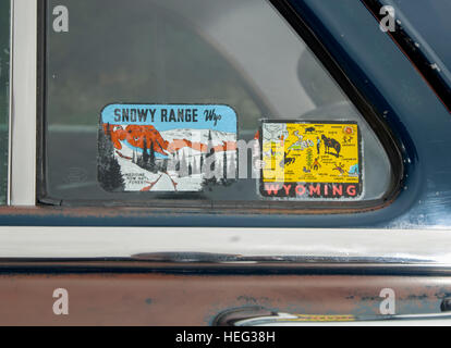Object travel art vintage holiday travel window stickers in the screen of a 1952 ford mainline american classic car