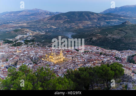 Jaen city overview at dusk with illuminated cathedral. Jaén, Andalusia, Spain - Stock Photo