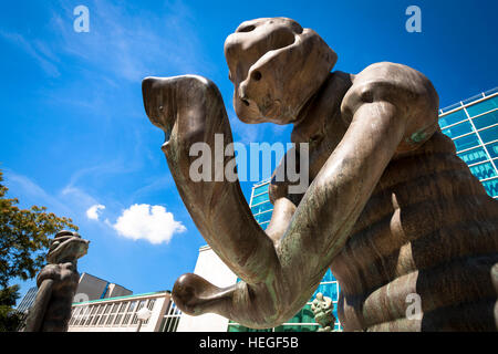 Germany, Essen, bronze sculptures  in front of the glas foyer of the Philharmonie, Saalbau. - Stock Photo
