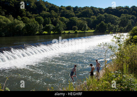 Germany, Witten, river Ruhr, boys jumping in the river at the spillway at the sluice in Herbede. - Stock Photo