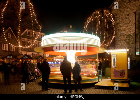 Germany, Ruhr Area, Hattingen, Christmas market in the historic part of the town, carousel. - Stock Photo