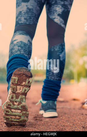 Young fitness woman legs running. - Stock Photo
