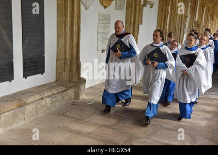 Girl choristers from Wells Cathedral Choir rehearse for evensong chorister duty in the quire at Wells Cathedral. - Stock Photo