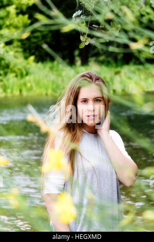 Attractive Caucasian Teen Girl Standing By River Gray Top - Stock Photo