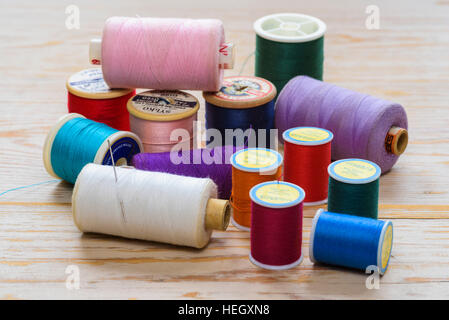 Assorted colourful cotton reels.Needlework yarn. - Stock Photo