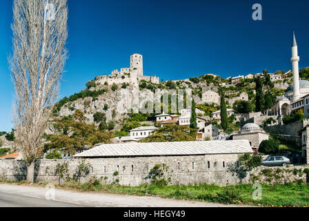 scenic view of pocitelj village traditional old architecture buildings and mosque in Bosnia Herzegovina - Stock Photo