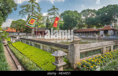 Courtyard with the pool, flags, and traditional buildings at the Temple of Literature (Van Mieu-Quoc Tu Giam), Hanoi, - Stock Photo