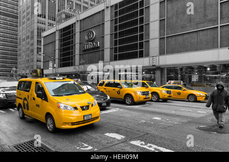 NEW YORK - MAY 3, 2016: Typically yellow medallion taxicabs in front of the New York Hilton. They are widely recognized - Stock Photo