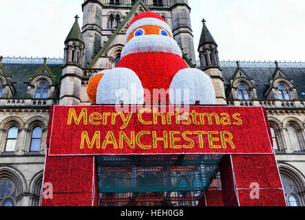 Large Father Christmas & Merry Christmas Manchester sign on Manchester town Hall - Stock Photo