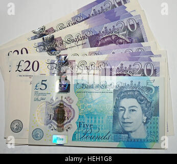 It was reported that England's new polymer bank notes are made with beef tallow, upsetting vegans. - Stock Photo