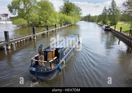 A narrow boat cruising on the river Thames at Hambleden lock, Berkshire, England - Stock Photo