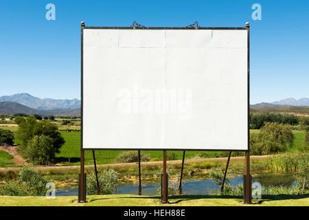 Big blank billboard in nice scenery - Stock Photo