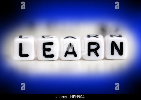 Learn word made from plastic beads on blue frame - Stock Photo