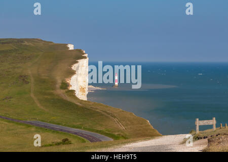 Looking at Beachy Heady with the lighthouse on a bright summer's day.  Shows a road, and a hiking track. - Stock Photo
