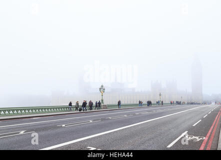 Tourists on Westminster Bridge, London. In London, England. On 17th December 2016. - Stock Photo