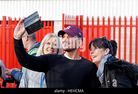 TV personality Peter Andre poses for photographs with fans before the Sky Bet League 2 match between Crawley Town - Stock Photo