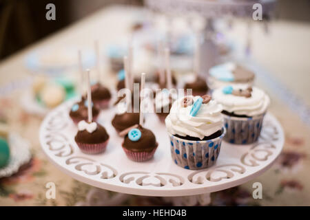Different delicious desserts and cakes on the buffet table - Stock Photo
