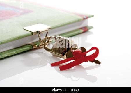Diary padlock, lock and key - Stock Photo