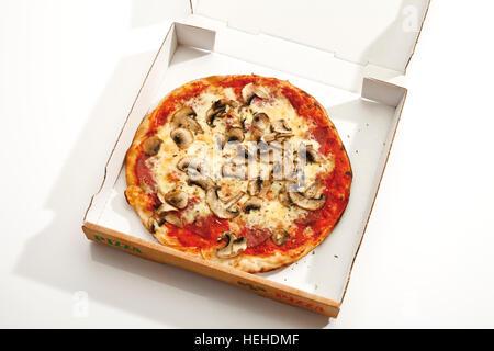Mushroom pizza in a delivery box - Stock Photo