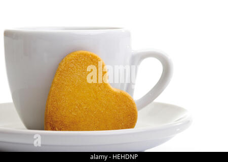 Cup of coffee and heart-shaped biscuit - Stock Photo