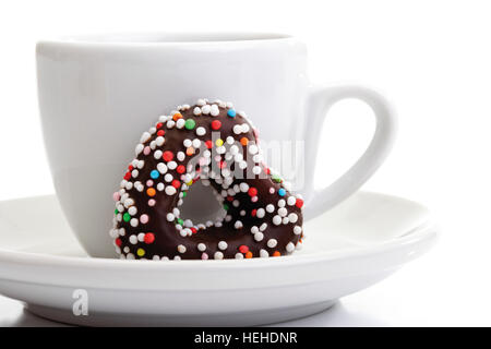 Cup of coffee and a chocolate heart - Stock Photo