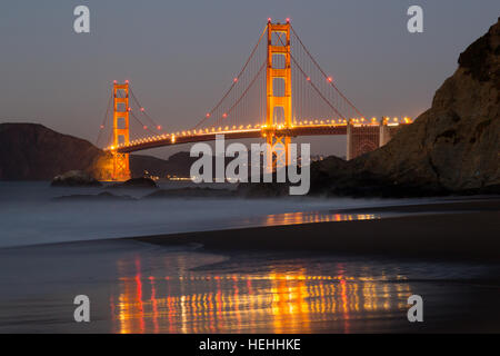 The Golden Gate Bridge and Baker Beach Reflections - Stock Photo