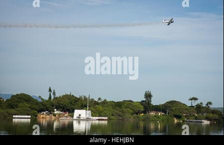 The Pacific Warbirds conduct a vintage plane flyby during the 75th Anniversary National Pearl Harbor Remembrance - Stock Photo