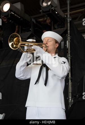A U.S. Pacific Fleet Band member performs Taps on a bugle during the 75th Commemoration Event of the attacks on - Stock Photo