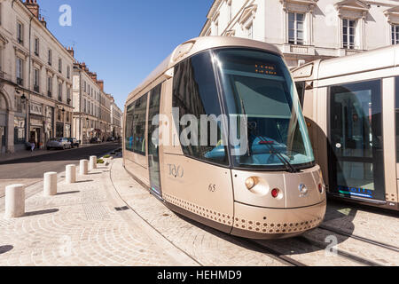 Two trams pass in rue Jeanne d'Arc in orleans, France. - Stock Photo