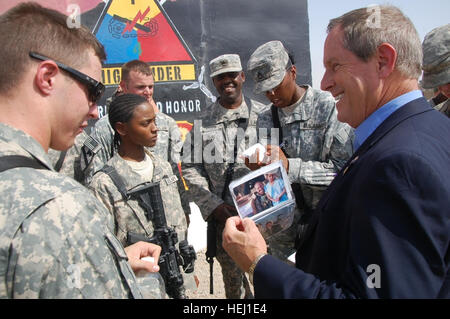 Rep. Joe Wilson shows a photo of his son, Alan, a major in the Army National Guard who served a year at Contingency - Stock Photo