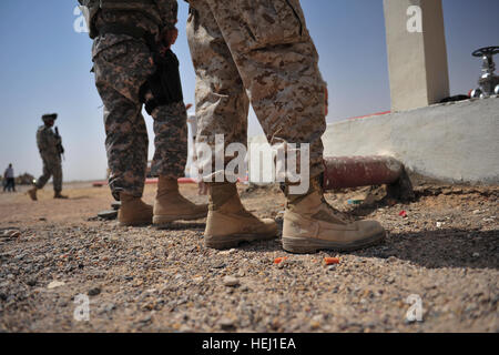The Anbar Provincial Reconstruction Team attends a meeting at the Fuel Distribution Center in Ar Ramadi, Iraq, Aug. - Stock Photo