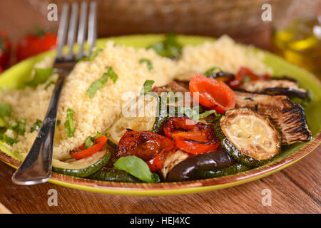 couscous with grilled vegetables on the plate - Stock Photo