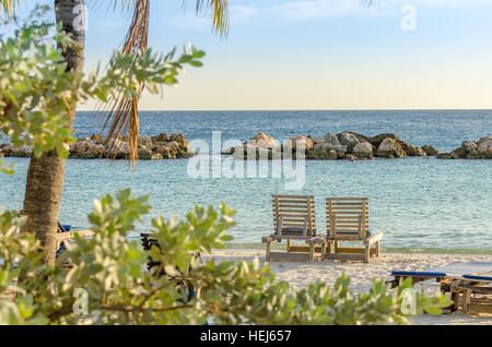 Front row seats by the sea at the mambo beach in Curacao - Stock Photo
