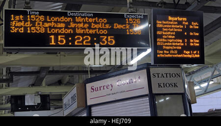 Christmas Festive Humour on South West Trains information displays, Central London,England,UK - Stock Photo