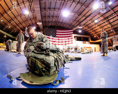 Staff Sgt. Aaron Butler, the Army Reserve Non-commissioned Officer of the Year, packs his equipment during PCC/PCI - Stock Photo