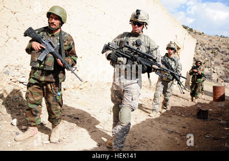 U.S. Army Sgt. William Corcoran of Alpha Troop, 1st Squadron, 33rd Cavalry Regiment, leads a patrol through Spera, - Stock Photo