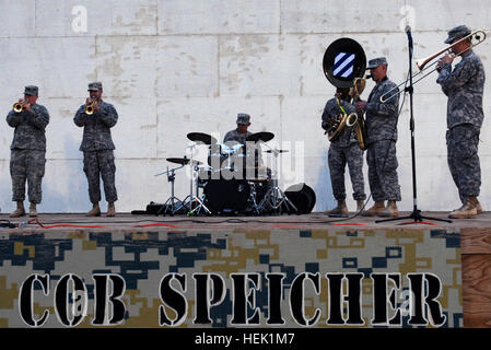 Sgt. Justin T. Miller, a trumpet player with the 3rd Infantry Division Band, Division Special Troops Battalion, - Stock Photo