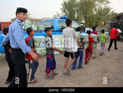 Iraqi Police help impoverished citizens by delivering 120 water filters to Iraqis in the village of Al Jaffes as - Stock Photo