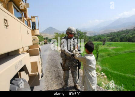 Staff Sgt. Joey Evans of Johnsonville, S.C., Security Force, Nuristan Provincial Reconstruction Team, talks with - Stock Photo