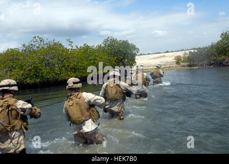 Marines wade through water after exiting a transportable port security boat at U.S. Naval Station Guantanamo Bay, - Stock Photo