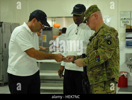 BAGRUM AIRFIELD, Afghanistan – U.S. Army Sgt. 1st Class Todd Edler a Anamosa, Iowa resident and the food service - Stock Photo