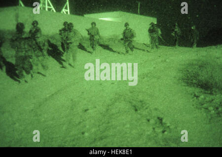 Commandos, from 1st Company, 6th Commando Kandak, practice night movements utilizing night vision goggles at Camp - Stock Photo