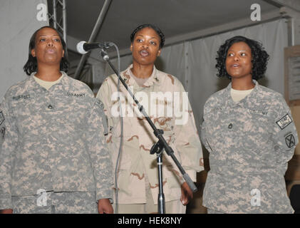 (From left) U.S. Army Staff Sgt. Cecilia Russell, Joint Sustainment Command - Afghanistan, U.S. Navy Logistics Support - Stock Photo