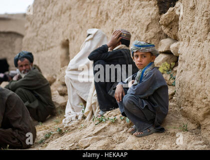 A young Afghan boy observes as Afghan Commandos, with the Afghan National Army's 3rd Commando Kandak , and U.S. - Stock Photo