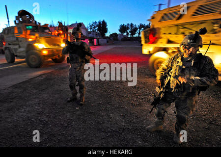 Security personnel from Provincial Reconstruction Team Zabul depart for the Zabul Provincial Hospital after an improvised - Stock Photo